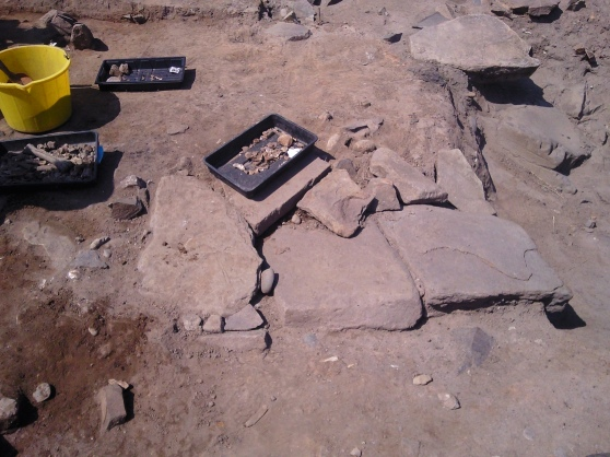 The full extent of the stone slab feature as revealed by further excavation