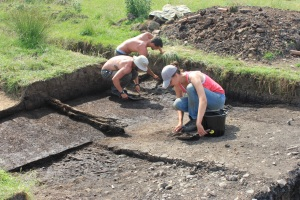 Excavation at the Bradford Kaims wetland site in 2013. A waterlogged Neolithic timber platform is just starting to emerge