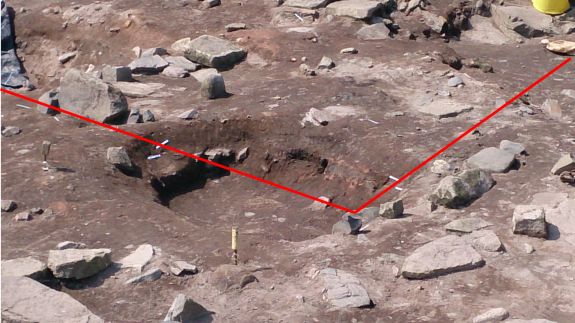 The southern beam slot became apparent in the sections of the southern latrine pit