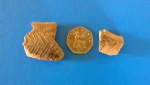 The to sherds of pottery, decorated by incised lines. Whilst not joining fragments, they may be part of the same vessel