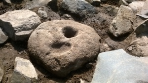 The newly identified quern stone we believe was re-used as a post support