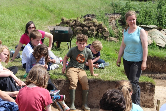 3-Assistant Supervisor, Rachel Brewer teaching the children about Trench 6..jpg